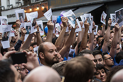 Old Compton Street, Soho, London, June 13th 2016. Thousands of LGBT people and their friends converge on Old Compton Street in London's Soho to remember the fifty lives lost in the attack on gay bar Pulse in Orlando, Florida. PICTURED: Men from the London Gay men's Chorus hold aloft placards with the faces of the Orlando victims.