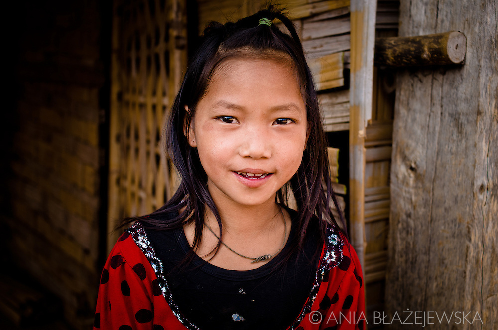 Laos, Muang Sing. Portrait Ad an Akha girl who lives in one of the Akha villages in the Muang Sing area.