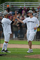 KELOWNA, CANADA - JUNE 28: Retired NHL player Josh Gorges high fives Montreal Canadiens goalie Carey Price at the start of the opening charity game of the Home Base Slo-Pitch Tournament fundraiser for the Kelowna General Hospital Foundation JoeAnna's House on June 28, 2019 at Elk's Stadium in Kelowna, British Columbia, Canada.  (Photo by Marissa Baecker/Shoot the Breeze)