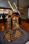 Yoroi type samurai armor, with purple lacing in the saka omodaka style, by Zennosuke in the Meiji era, 1900s. The Tokyo National Museum is the oldest and largest of Japan's top-level national museums. Located in Ueno Park, Tokyo, Japan.
