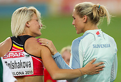Third placed Svetlana Bolshakova of Belgium and Snezana Rodic of Slovenia after competing in the women's triple jump final at the 2010 European Athletics Championships at the Olympic Stadium in Barcelona on July 31, 2010.(Photo by Vid Ponikvar / Sportida)