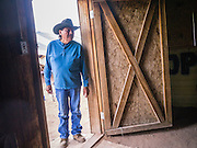 "13 JULY 2012 - FT DEFIANCE, AZ:     A man looks into the dining hall at the 23rd annual Navajo Nation Camp Meeting in Ft. Defiance, north of Window Rock, AZ, on the Navajo reservation. In addition to preaching and prayer, there are classes on horsemanship at the camp meeting. Preachers from across the Navajo Nation, and the western US, come to Navajo Nation Camp Meeting to preach an evangelical form of Christianity. Evangelical Christians make up a growing part of the reservation - there are now more than a hundred camp meetings and tent revivals on the reservation every year. The camp meeting in Ft. Defiance draws nearly 200 people each night of its six day run. Many of the attendees convert to evangelical Christianity from traditional Navajo beliefs, Catholicism or Mormonism. ""Camp meetings"" are a form of Protestant Christian religious services originating in Britain and once common in rural parts of the United States. People would travel a great distance to a particular site to camp out, listen to itinerant preachers, and pray. This suited the rural life, before cars and highways were common, because rural areas often lacked traditional churches.PHOTO BY JACK KURTZ"