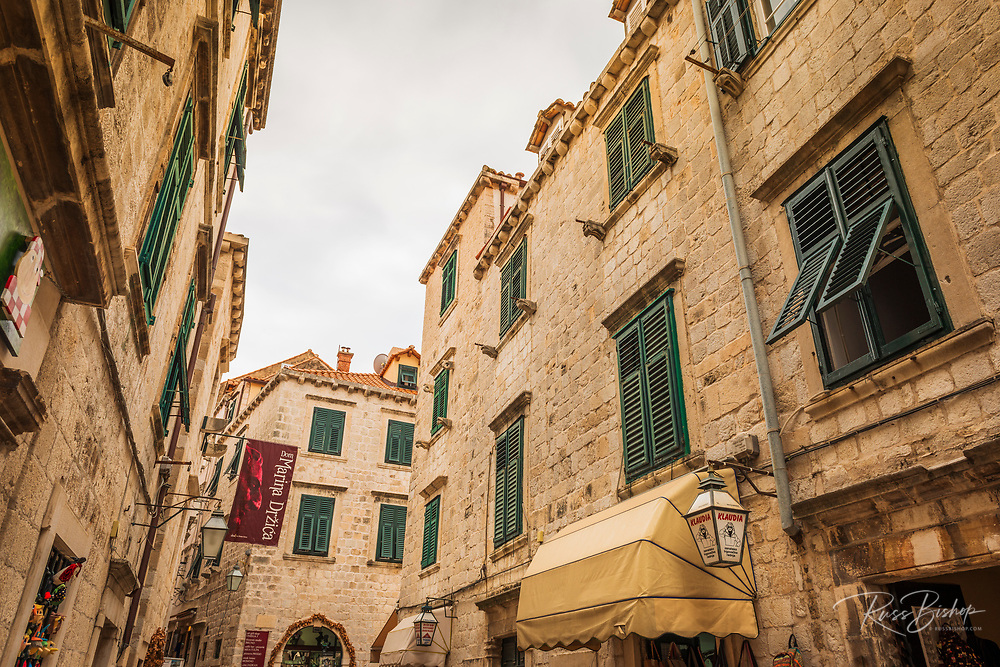 Narrow street and shops in old town Dubrovnik, Dalmatian Coast, Croatia