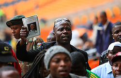 Mandela Memorial Service.<br /> 0813446  <br /> A man holds a schedule of the memorial service of the former South African president Nelson Mandela before the memorial service at the FNB Stadium in Soweto near Johannesburg, South Africa, Tuesday, 10th December 2013. Picture by  imago / i-Images<br /> <br /> UK ONLY
