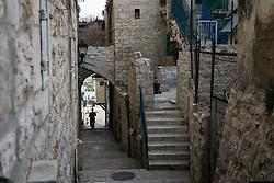 2 May 2016, Bethlehem, Palestine: A woman walks down a street in Bethlehem.