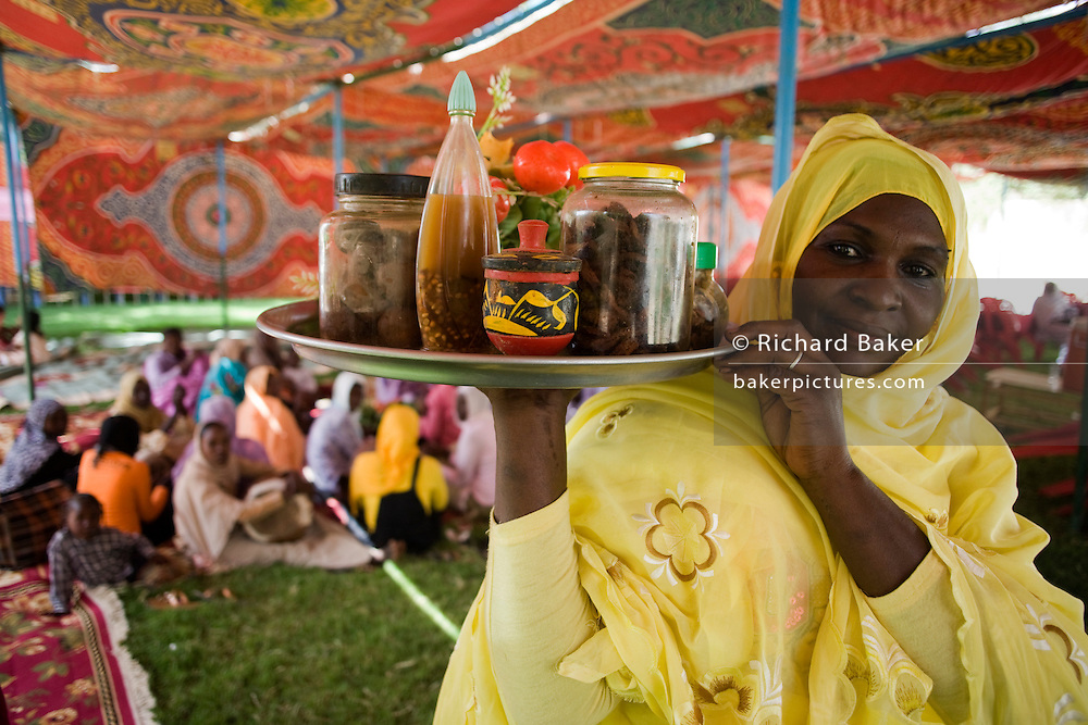 Ladies attending the first-ever international Conference on Womens' Challenge in Darfur, gather in a compound tent belonging to the Govenor of North Darfur in Al Fasher (also spelled, Al-Fashir) where the women from remote parts of Sudan gathered to discuss peace and political issues.