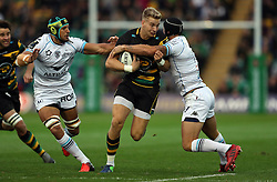 Northampton Saints' Harry Mallinder gets through Montpellier's Pierre Spies and Alexandre Dumoulin during the European Champions Cup, pool four match at Franklin's Gardens, Northampton.