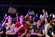 The Cardiff crowd enjoy the darts. McCoy's Premier league darts, week 7 event at the Motorpoint Arena in Cardiff, South Wales on Thursday 21st March 2013. pic by Andrew Orchard, Andrew Orchard sports photography,