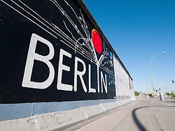 Mural painted on wall at East Side Gallery at former Berlin Wall in Friedrichshain/Kreuzberg in Berlin Germany