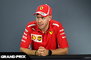 SINGAPORE - SEPTEMBER 16: Sebastian Vettel (5) of Scuderia Ferrari reaction during the Driver Press Conference at F1 Singapore Grand Prix 2018, Marina Bay Street Circuit, Singapore on September 16, 2018. <br /> .<br /> .<br /> .<br /> (Photo by: Naratip Golf Srisupab/SEALs Sports Images)<br /> .<br /> Any image use must include a mandatory credit line adjacent to the content which should read: Naratip Golf Srisupab/SEALs Sports Images