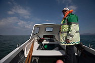Dr David Binnie on his boat sailing off the the Inner Hebridean island of Colonsay on Scotland's west coast.  The island is in the council area of Argyll and Bute and has an area of 4,074 hectares (15.7 sq mi). Aligned on a south-west to north-east axis, it measures 8 miles (13 km) in length and reaches 3 miles (4.8 km) at its widest point, in 2019 it had a permanent population of 136 adults and children.