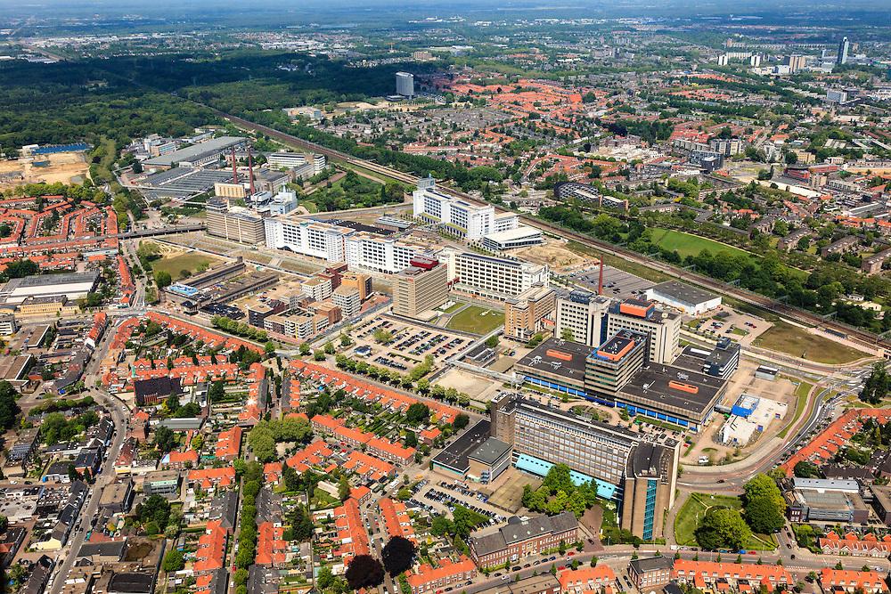 Nederland, Noord-Brabant, Eindhoven, 27-05-2013; Strijp-S, voormalige Philipsterrein, was niet toegankelijk voor het publiek, 'de verboden stad'. Het gebied, met diverse Rijksmonumenten, wordt ontwikkeld voor wonen, werken en cultuur.<br /> Boven in beeld Philitefabriek met Klokgebouw (Strijp S), in het midden het Veemgebouw met daar direct naast De Hoge (Witte) Rug. <br /> Strijp-S, former Philips area, was not accessible to the public, 'the forbidden city'. The area, with several national monuments, is designated for living, working and culture.<br /> Top image Philitefabriek / Clock Building (Strijp S), in the middle of the Veemgebouw next to the High (White) Back. <br /> luchtfoto (toeslag op standard tarieven);<br /> aerial photo (additional fee required);<br /> copyright foto/photo Siebe Swart