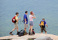 Bear Mountain, New York - A man and a woman, at center, enjoy the view after hiking up the Appalachian Trail at Bear Mountain as two other hikers head down from the summit on June 5, 2010.