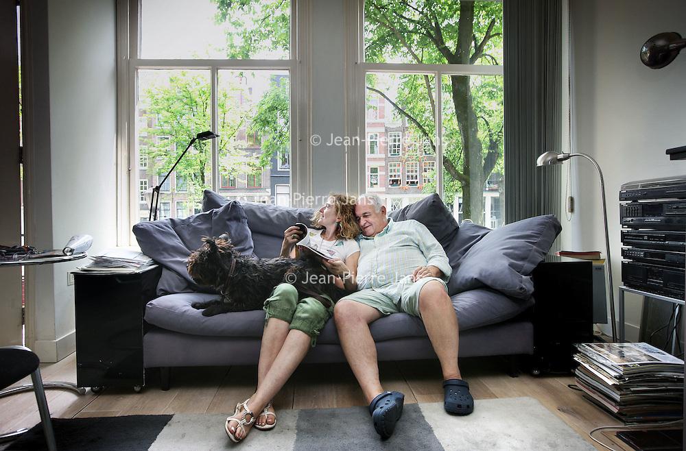Nederland, Amsterdam , 14 juli 2010..Claudia Liedtke en Claus Müller uit Mallorca hebben voor de vakantie hun woning geruild met een grachtenpand op de Bloemgracht.Portraits of foreigners who exchange houses in Amsterdam.