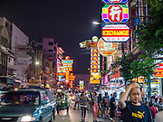 25 OCTOBER 2014 - BANGKOK, THAILAND: People walk down Yaowarat Road in Bangkok. Yaowarat Road is the center of the Bangkok Chinatown neighborhood and is famous for the street food. Most of the food stalls open after sunset.     PHOTO BY JACK KURTZ