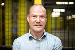 """© Licensed to London News Pictures . 04/12/2019. Manchester , UK .  General Manager of MAN1 warehouse NEIL TRAVIS . Inside the """"MAN1"""" Amazon fulfilment centre warehouse at Manchester Airport in the North West of England . Photo credit : Joel Goodman/LNP"""