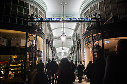 """© Licensed to London News Pictures. 14/01/2016. London, UK. """"I Haven't Changed my Mind in a Thousand Years"""" by Beth J Ross in the Piccadilly Arcade. The work forms part of Lumiere London, a major new light festival which commenced today to be held over four evenings and featuring artists who work with light.  The event is produced by Artichoke and supported by the Mayor of London.  Photo credit : Stephen Chung/LNP"""