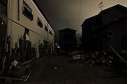 """""""ISHINOMAKI - Utter Darkness"""" shows the neighbourhoods most affected by the tsunami, under minimal light. The town is asleep; the streets dark. Some outlines are visible. The photographs may hint at normalcy, yet a few details remind us of the true situation."""