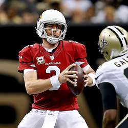 Sep 22, 2013; New Orleans, LA, USA; Arizona Cardinals quarterback Carson Palmer (3) is pressured by New Orleans Saints outside linebacker Junior Galette (93) during the first half of a game at Mercedes-Benz Superdome. The Saints defeated the Cardinals 31-7. Mandatory Credit: Derick E. Hingle-USA TODAY Sports