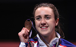 Great Britain's Laura Muir celebrates with her Gold medal after the Women's 3000m, during day one of the 2018 IAAF Indoor World Championships at The Arena Birmingham, Birmingham.