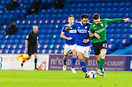 Cardiff City's Marlon Pack (21) and Birmingham City's Jon Toral (23) clash during the EFL Sky Bet Championship match between Cardiff City and Birmingham City at the Cardiff City Stadium, Cardiff, Wales on 16 December 2020.
