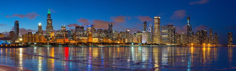 Chicago's fantastic downtown skyline reflected in a frozen Lake Michigan on a extremely cold March 4th evening, 2019. Exterior Architectural Photography. Buildings, locations, architecture. Chicago, Illinois, built landscape,