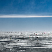 View out my dorm window at South Pole Station. The flag on the left marks the geographic South Pole, the structure on the right is part of the South Pole SuperDARN antenna array. All the small flags mark safe routes when visibility is low, and no-go zones. And yes, that wind is blowing hard.