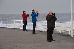 © London News Pictures. 01/02/2014. Aberystwyth, UK. Photographer line up to watch waves crash on to the seafront at Aberystwyth in Wales where locals are braced for further storms battering the coastline. The seafront at Aberystwyth was badly damaged by strong storm weather just a few weeks ago. Photo credit: Keith Morris/LNP