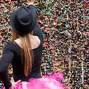 A ballet dance sticks a piece of bubble gum to the bubble gum wall in Seattle, Washington.