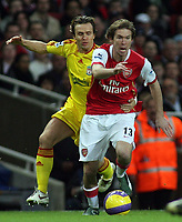 Photo: Paul Thomas.<br /> Arsenal v Liverpool. The Barclays Premiership. 12/11/2006.<br /> <br /> Liverpool's Bolo Zenden (L) tries to tackle Alexander Helb.