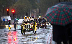 © London News Pictures. 04/11/2012. London, UK.  Vehicles cross Westminster Bridge in London during the 2012 London to Brighton Veteran Car Run on November 4, 2012.  Over 500 vehicles built before 1905 take part in the annual run which attracts competitors from all over the world. Photo credit: Ben Cawthra/LNP.