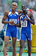 Marc Raquil (477) and Leslie Dijohne (463) of France celebrate after the second round of the 400-meter finals after both advanced to the final in the IAAF World Championships in Athletics at Stade de France on Sunday, Aug, 24, 2003.