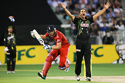 © Licensed to London News Pictures. 26/12/2013. Nathan Coulter-Nile appeals for an LBW as Jos Butler runs around him during the 2nd T20 international between Australia Vs England at the Melbourne Cricket Ground, Victoria, Australia. Photo credit : Asanka Brendon Ratnayake/LNP