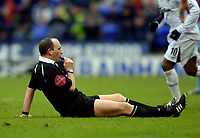 Photo: Jed Wee.<br />Bolton Wanderers v West Ham United. The Barclays Premiership. 11/03/2006.<br /><br />Referee Mike Dean has to blow the whistle to halt the game as he ends up sprawled on the pitch.