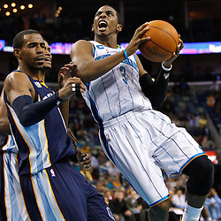 January 19, 2011; New Orleans, LA, USA; New Orleans Hornets point guard Chris Paul (3) shoots over Memphis Grizzlies point guard Mike Conley (11) during the fourth quarter at the New Orleans Arena. The Hornets defeated the Grizzlies 130-102 in overtime.  Mandatory Credit: Derick E. Hingle