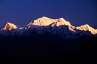 Sunrise on the Kanchenjunga Range (28,208 foot Mt. Kanchenjunga in center), West Sikkim, India