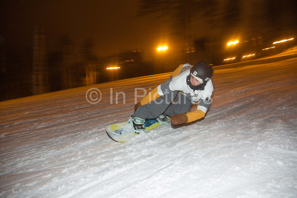 Night snowboarding at Ozolkalns ski resort on the 13th February 2019 in Ozolkalns in Latvia. The small ski resort of Ozolkalns is located near the historic town of Cesis in north eastern Latvia.