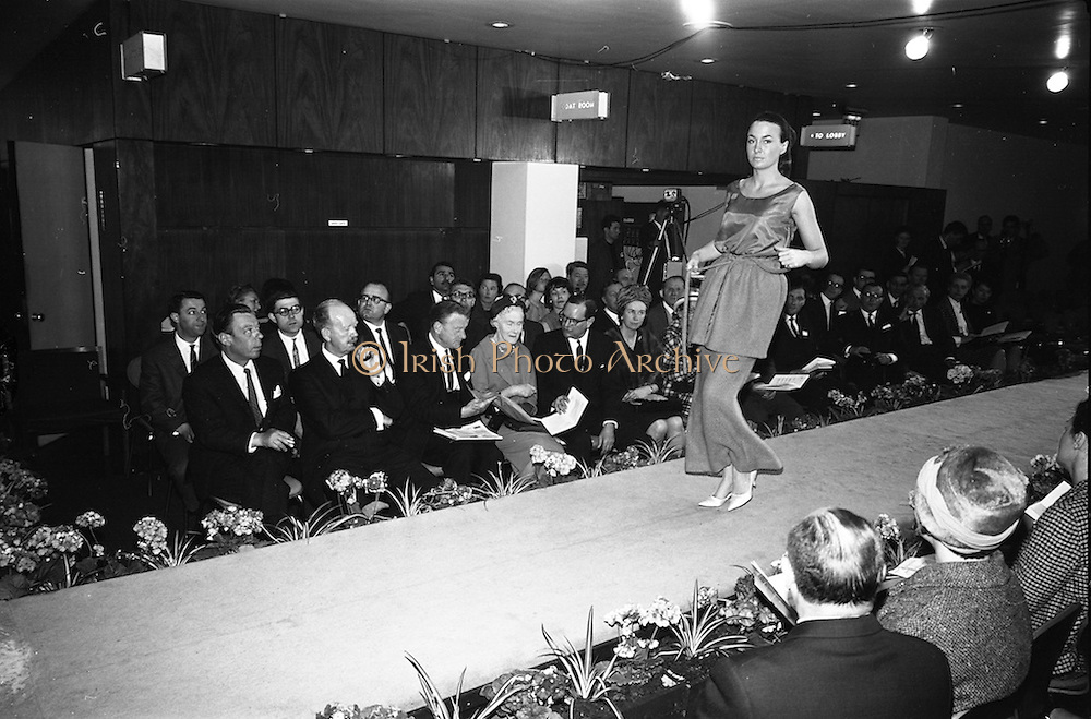 05/04/1965<br /> 04/05/1965<br /> 05 April 1965<br /> Second Irish Export Fashion Fair opened at the Intercontinental Hotel, Dublin. Picture shows Mr W.H. Walsh, General Manager Coras Trachtala; Mr J.C.B. McCarthy, Secretary, Department of Industry and Commerce, who opened the Fair and Mr John Haughey, Chairman of Coras Trachtala watching the fashion parade.