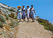 Four women on holiday walking down path on island of Ibiza, Balearic Islands, Spain, 1950s