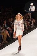 White shorts with laced sides and a pink, yellow and blue plaid jacket.