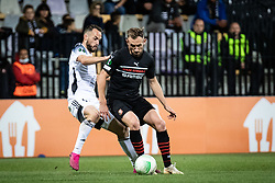 Ziga Kous of NS Mura and Flavien Tait of Rennes during football match between NS Mura and Rennes (FRA) in group stage of UEFA Europa Conference League 2021/22, on 20 of October, 2021 in Ljudski Vrt, Maribor, Slovenia. Photo by Blaž Weindorfer / Sportida