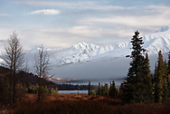 The morning after a storm has laid the first snow on the mountains of the Kenai Peninsula, Alaska
