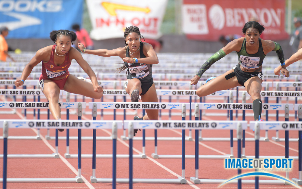 Apr 21, 2018; Torrance, CA, USA; Chanel Brissett of Southern California (left) defeats Tara Davis of Georgia (center) and Eric Bougard to win a women's 100m hurdles heat in 12.94 during the 60th Mt. San Antonio College Relays at Murdock Stadium.