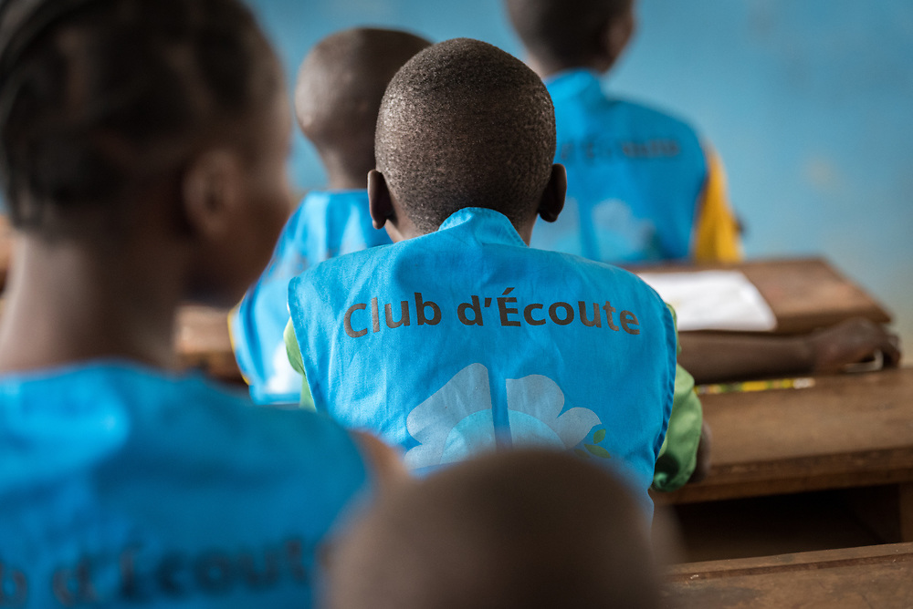 3 June 2019, Djohong, Cameroon: At the Ecole Publique de Borgop' (Public School of Borgop), children participate in 'the Listening Club', where today painter and consulting artist Dogari Samson leads a specific eight-day intervention to teach the children how to make drawings with images and messages of peace. The Borgop refugee camp is located in the municipality of Djohong, in the Mbere subdivision of the Adamaoua regional state in Cameroon. Supported by the Lutheran World Federation since 2015, the camp currently holds 12,300 refugees from the Central African Republic.
