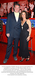 TV DIY presenter TOMMY WALSH and his wife MARIE at a reception in London on 18th March 2003.PIC 16