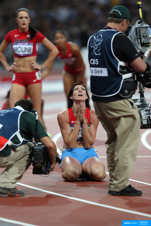 Natalya Antyukh, Russia,  wins the  Gold Medal during the Women's 400m Hurdles Final and celebrates in front of TV camera's  at the Olympic Stadium, Olympic Park, during the London 2012 Olympic games. London, UK. 8th August 2012. Photo Tim Clayton