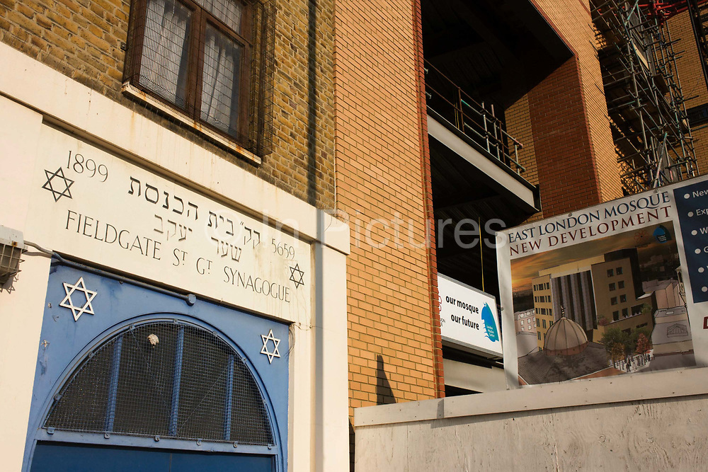 The Victorian Fieldgate Street Synagogue next door to the construction site of the new East London Mosque in east London. In a scene of friendship and a spirit of multi-faiths in this area of east London which was once a mainly Jewish neighbourhood but nowadays, since the rise in immigration from south Asia and the middle-east, is now predominantly Muslim and home to many local mosques and Islamic centres. It is a symbol of inter-denominational integration that such religions can live side by side.