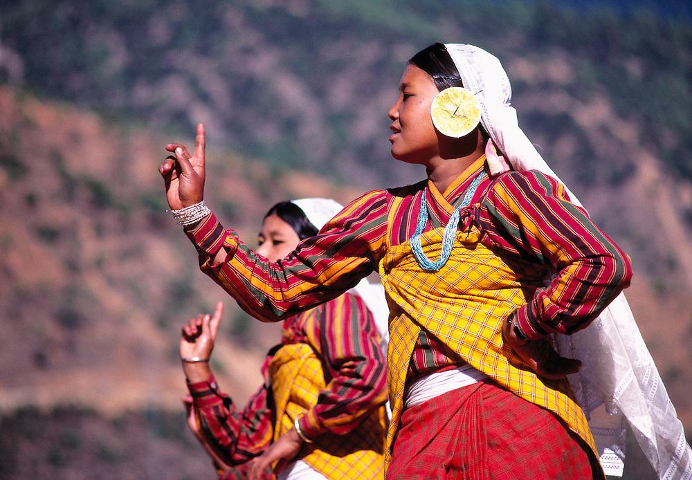 Female dancers demonstrate a typical Bhutanese dance at Thimphu, Bhutan.
