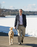 Steve Tucker and Finnegan on a morning walk.  (Karen Bobotas/for the Laconia Daily Sun)
