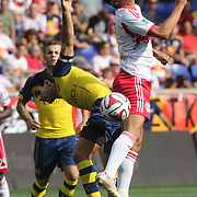 Tim Cahill, New York Red Bulls, wins a header from Mikel Arteta, Arsenal, during the New York Red Bulls Vs Arsenal FC,  friendly football match for the New York Cup at Red Bull Arena, Harrison, New Jersey. USA. 26h July 2014. Photo Tim Clayton